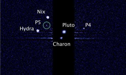 This image, taken by the NASA/ESA Hubble Space Telescope, shows five moons orbiting Pluto, the distant, icy dwarf planet