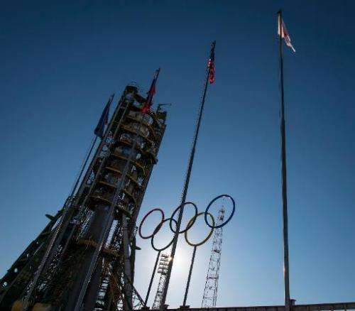 This NASA handout photo shows Olympic rings at the Soyuz launch pad shortly after the Soyuz TMA-11M rocket was erected into posi