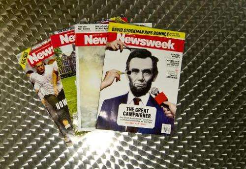 This October 18, 2012 photo illustration shows copies of Newsweek magazine in Washington, DC