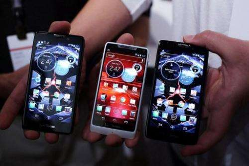 Three Motorola Razr smartphones, which use Google's Android operating system, are displayed on September 5, 2012