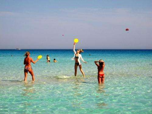 Tourists on Nissi beach in Cyprus on May 1, 2013