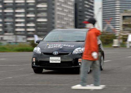 "Toyota Motor demonstrates its ""pre-collision system"", which uses automatic steering in addition to automatic braking t"