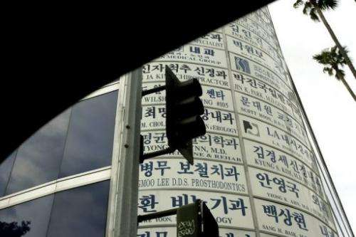 Traffic signals and advertisements are pictured from inside an automobile in Los Angeles on April 27, 2005
