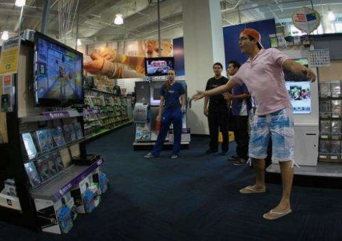 Vicente Galarza plays a Microsoft Kinect game at the Best Buy store on November 4, 2010 in Miami Beach, Florida