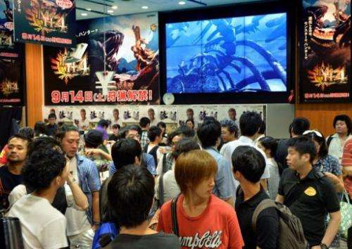 Videogame fans queue up to buy 'Monster Hunter 4' in Tokyo on September 14, 2013