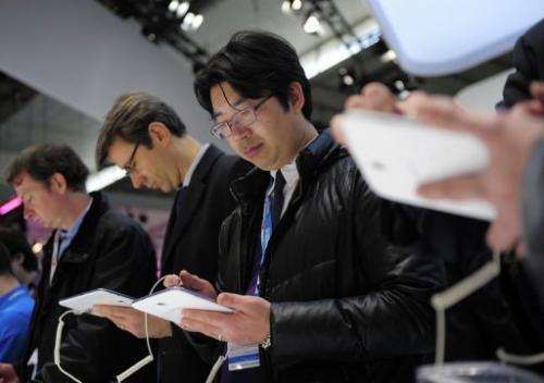 Visitors check a Samsung Galaxy note tablet at the 2013 Mobile World Congress in Barcelona, on February 26, 2013