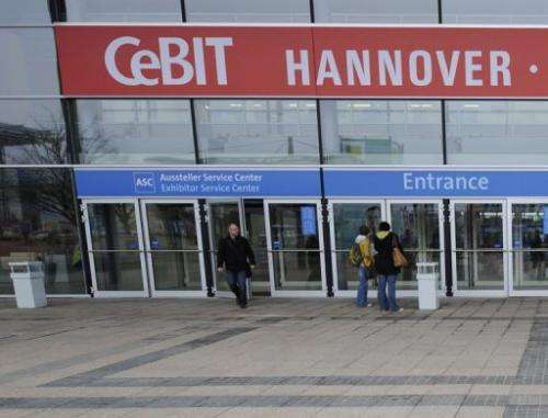Visitors leave the world's biggest high-tech fair, the CeBIT, in Hanover March 5, 2009