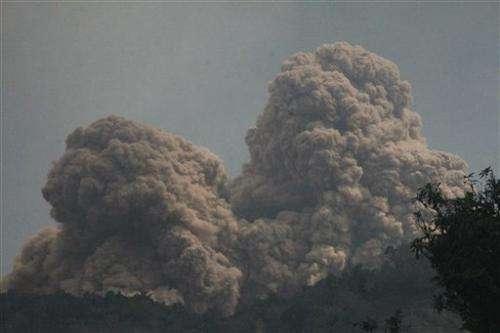 Volcano spews more hot ash, lava in east Indonesia
