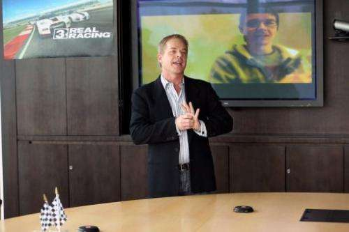VP of mobile publishing at Electronic Arts, Nick Rish, speaks during a Real Racing 3 preview, February 7, 2013