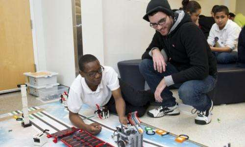 Young engineers build a robotic bridge to reach seniors