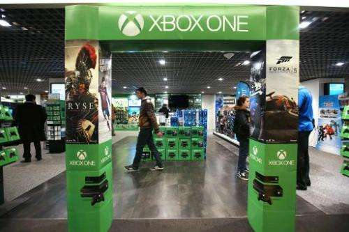 An adverstising gate presenting the new XBox One game console is pictured in a store in Paris on November 22, 2013