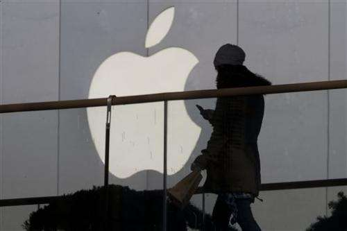Apple increases stock buyback, will split stock