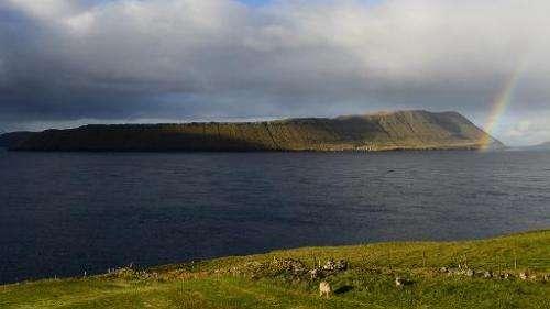 A rainbow appears above the Hestur island on October 16, 2012, Faroe Islands