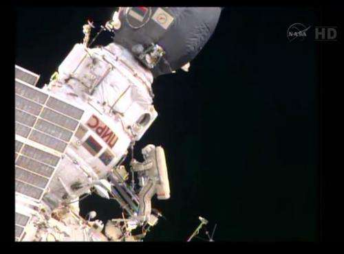 Astronauts repeat spacewalk, with mixed success