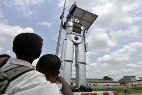 A traffic robot cop is seen on Triomphal boulevard in Kinshasa, at the crossing of Asosa, Huileries and Patrice Lubumba streets,