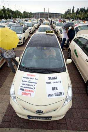 Berlin taxi drivers hail city's Uber ban