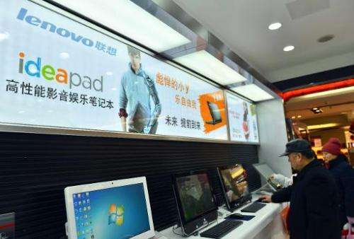 Chinese customers check out the computers at a Lenovo shop in Hangzhou, Zhejiang province on February 2, 2014