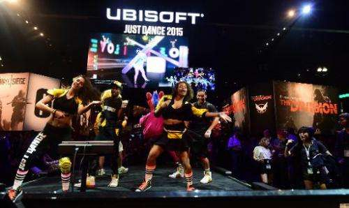 Dancers perform at Ubisoft's 'Just Dance 2015' at the annual E3 video game extravaganza in Los Angeles on June 10, 2014