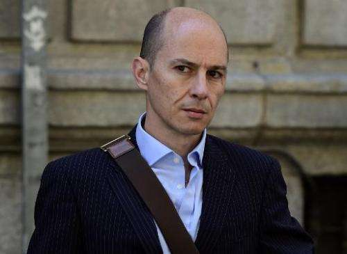 Disgraced ex-boss of Spanish wifi provider Let's Gowex Jenaro Garcia Martin leaves the courthouse in Madrid in July 2014