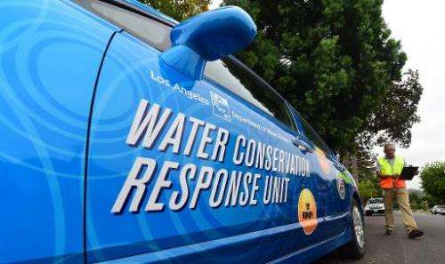 "Enrique Silva, a ""water policeman"" with the Water Conversation Response Unit in Los Angeles, returns to his vehicle af"