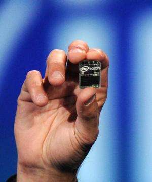 "Intel Corp. CEO Brian Krzanich introduces ""Intel Edison,"" a tiny Intel-based computer, during his pre-show keynote add"