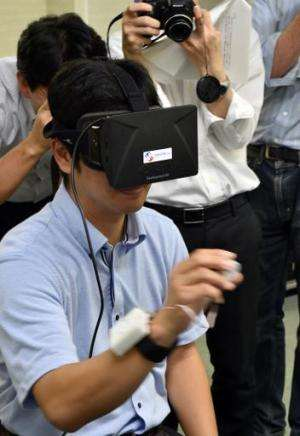 "Japan's high-tech venture Miraisens CEO Natsuo Koda demonstrates ""3D-Haptics technology"", at a press preview in Tsukub"