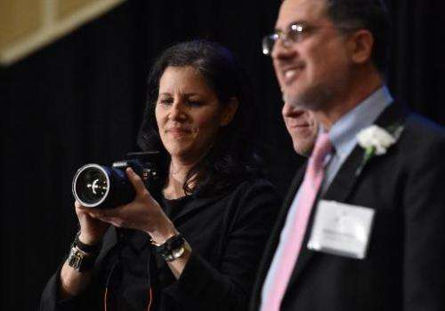 Laura Poitras (L) and Barton Gellman of The Washington Post accept Long Island University's George Polk Award for National Secur