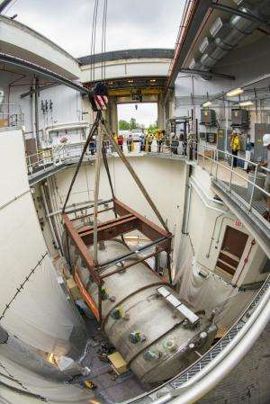 Massive 30-ton MicroBooNE particle detector moved into place, will see neutrinos this year