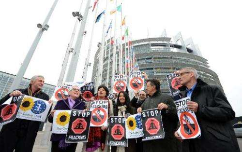"Members of the Greens/European Free Alliance group hold banners reading ""stop fracking"" before a vote in a plenary ses"