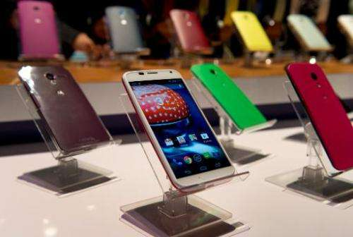 Motorola's Moto X is displayed in many different colors on August 1, 2013 at a news conference in New York