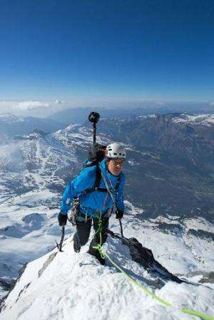 Mountaineer Stephan Siegrist climbs the Eiger's north face with a custom-made camera mounted on his backpack, in Switzerland, on