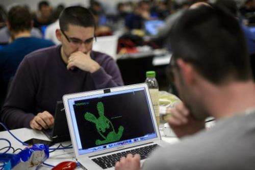 Participants compete behind their computers during the ethical hacking contest Insomni'hack 2014 on March 21, 2014 in Geneva