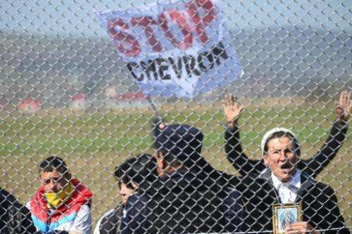 Protesters demonstrate on April 8, 2014 outside Chevron's exploration well in the village of Pungesti, Romania