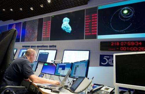 Rosetta space probe catches up with comet