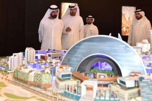 "Sheikh Mohammed of Dubai (left) looks at a mock-up of the ""Mall of the World"" project during its presentation in Dubai"