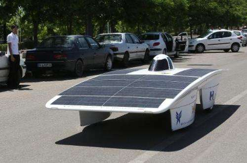 Studants from the Iran's Qazvin Azad Islamic University, test drive with the solar powered Havin-2 vehicle, in Qazvin on June 2,