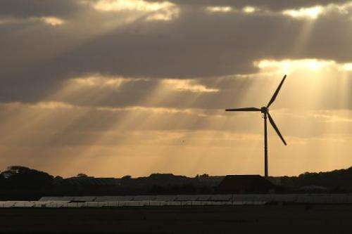 Sun rays over a wind and a solar hybrid park on Pellworm island, northern Germany on August 9, 2013