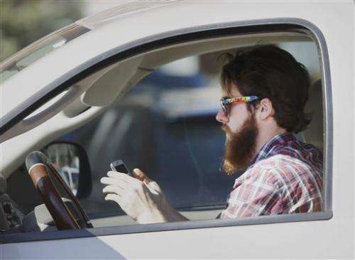 Survey finds people text and drive knowing dangers