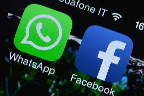 The Facebook and WhatsApp applications' icons are displayed on a smartphone on February 20, 2014 in Rome