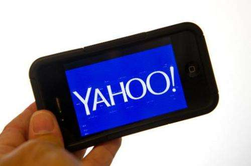 This September 12, 2013 photo illustration shows the Yahoo logo on a smartphone