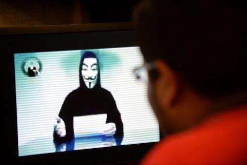 File photo shows a person claiming to speak for activist hacker group Anonymous issuing a warning to the Singapore government ov