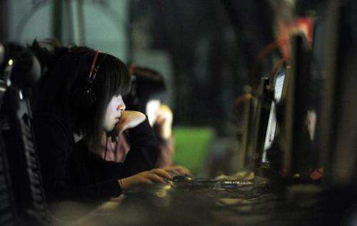 This photo taken on May 11, 2011 shows a Chinese young woman surfing the net at an Internet bar in Beijing