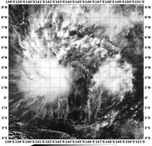 NASA sees Tropical Depression 05W's bulk west of center