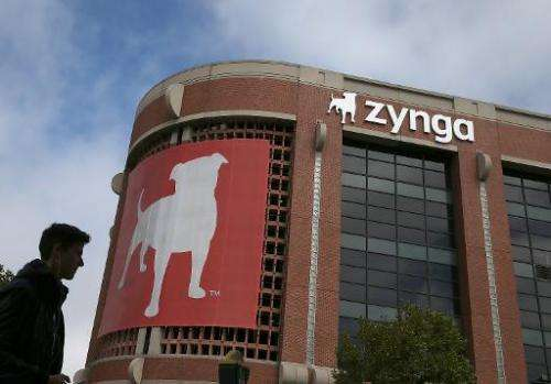 A pedestrian walks by the Zynga headquarters on July 25, 2013 in San Francisco, California