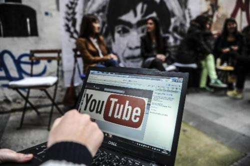 A person looks at YouTube on a laptop in Istanbul, on March 27, 2014