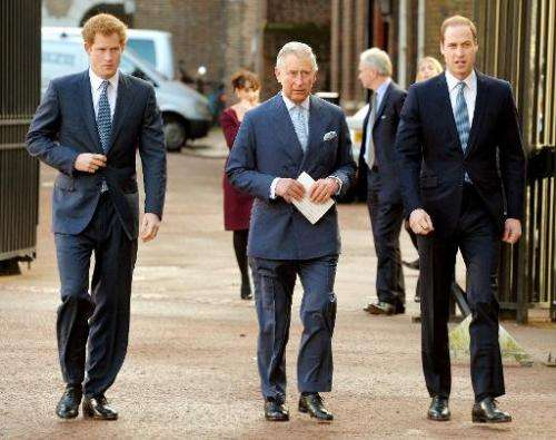 Britain's Prince Charles (C), Prince William (R), and Prince Harry (L) arrive for the Illegal Wildlife Trade Conference at Lanca