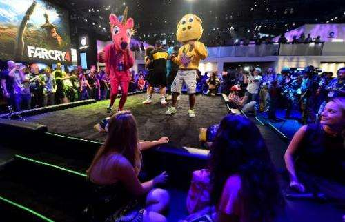 Dancers perform Ubisoft's 'Just Dance 2015' at the annual E3 video game extravaganza in Los Angeles on June 10, 2014