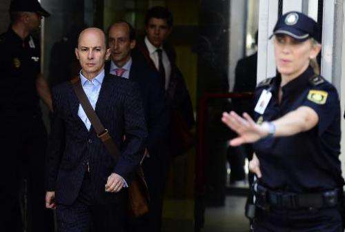 Disgraced ex-boss of Spanish wifi provider Let's Gowex Jenaro Garcia Martin (C) leaves the courthouse in Madrid on July 14, 2014