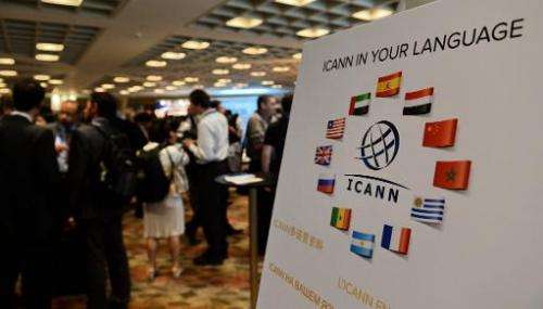 Participants take a break after the opening of the ICANN meeting in Singapore on March 24, 2014