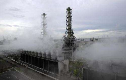Steam rises from the Kawasaki natural gas power station in Kawasaki City in Kanagawa prefecture, south of Tokyo on August 25, 20